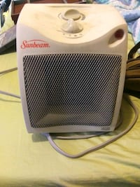 white and black Honeywell portable air cooler