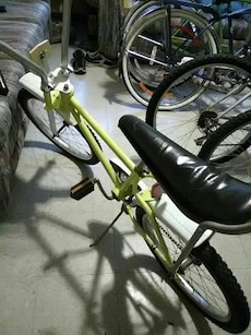 green and white banana saddle bike