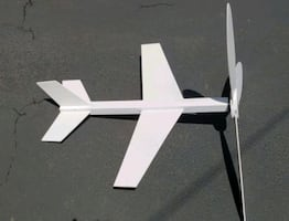 Wood airplane with bottom spike. Perfect for yard