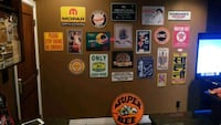 Vintage tin signs including 1940's tire advert from India Maple Ridge, V4R 2P6