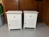 two white wooden 2-drawer nightstands Baltimore, 21224