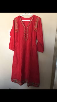 New red size med shirt with golden embroidery Calgary, T3K 6J7