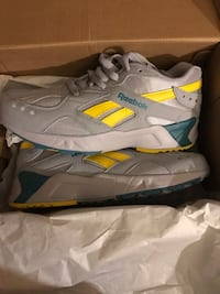 pair of gray-and-yellow running shoes Breaux Bridge, 70517