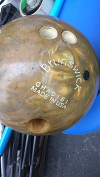 brown Brunswick bowling ball