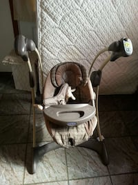 baby's gray and brown Graco swing chair