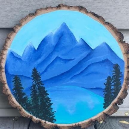 Painting of mountain with brown wooden frame