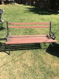brown wooden bench with black metal base Fresno, 93706