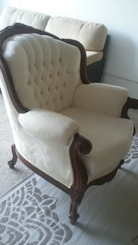 white and brown wooden framed armchair L4C