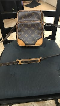 Black Louis Vuitton monogram canvas sling bag