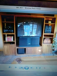 brown wooden TV hutch and flat screen TV 336 mi