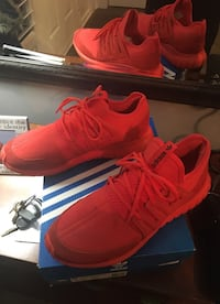 Brand new all red Adidas tubular Radial size 10US men's