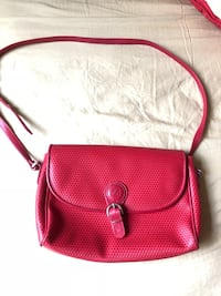 red leather crossbody bag with tassel