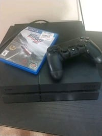 Sony PS4 console with controller and game cases 37 mi