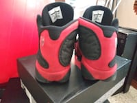 pair of red-and-black Nike basketball shoes Albuquerque