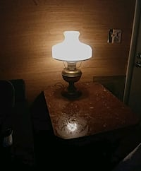 brass-colored and white table lamp & marble table