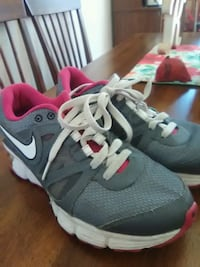 pair of gray Nike running shoes Bay City, 48706