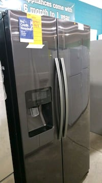 New Samsung side by side refrigerator 36x69.  Hauppauge