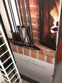 $40 New Fireplace tool set , $10 flower print canvas,$ 5 metal rack  Herndon, 20170