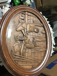 Man kneeling on floor holding soldier's right foot wall frame Dartmouth, B2W 2E3