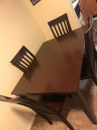 """Wood dining set table 30"""" h48x38"""" top with 4 chairs in good condition pick up in Gaithersburg md20877 Gaithersburg"""