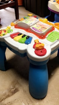 white and blue Fisher-Price activity table