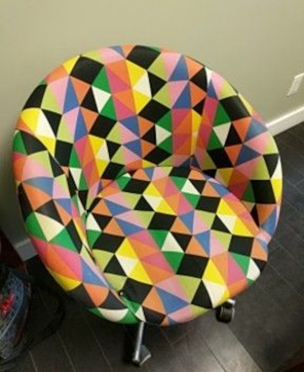 multicolored rolling armchair
