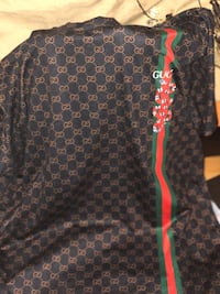 black and red floral long-sleeved shirt 748 mi