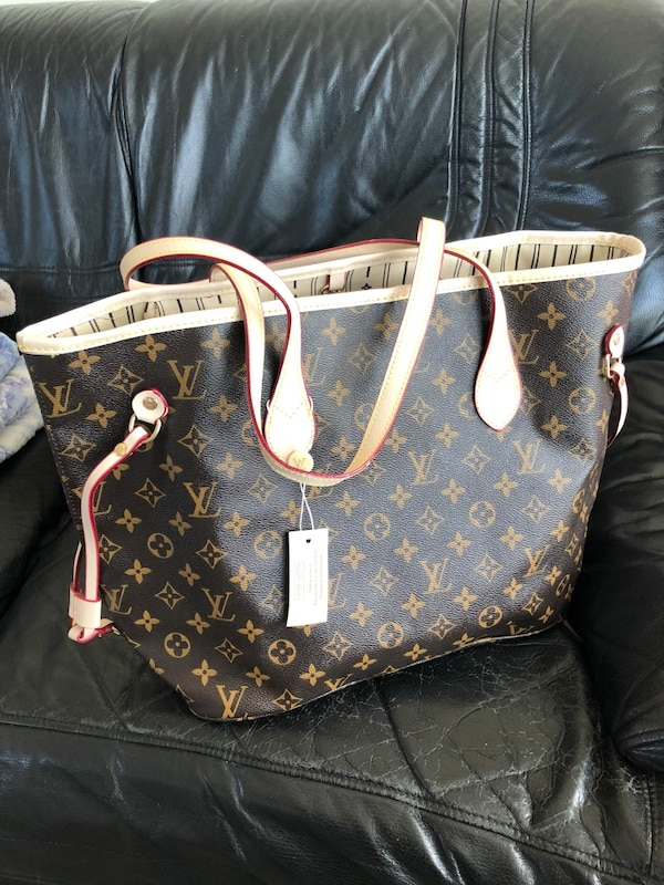 brown and black Louis Vuitton leather tote bag