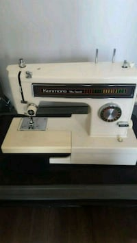 white and black Singer sewing machine Canmore, T1W 2Z7