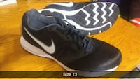 pair of black Nike running shoes Surrey, V3R 3S9