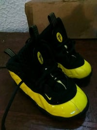 black-and-yellow Nike basketball shoes Akron