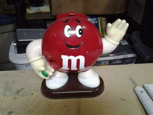 Photo Red and white M&M candy dispenser-----toy
