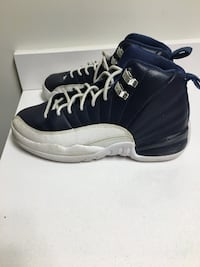 pair of black-and-white Air Jordan 12 Rockville, 20850