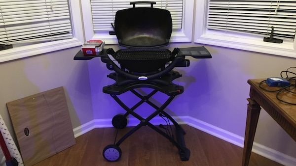 Weber Q1200 propane grill  Used several times and is in excellent  condition  Comes with stand, extra trays, cover, fork, Tonga, brush, and  propane