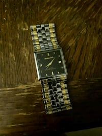 Silver and gold watch Narol, R1C 0C7