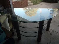 glass top half moon table with black steel frame