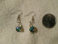 pair of silver-colored with sapphire heart dangle earrings; round silver commemorative coin Portland, 97266