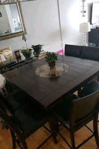 rectangular brown wooden table with four chairs di Raleigh, 27616