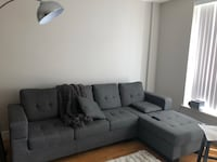 Gray fabric sectional sofa with throw pillows Toronto, M6B
