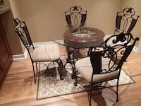 Round dinning room table and 4 chairs  Vaughan