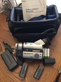 Sony Handycam with extra battery, AA battery pack (batteries not included), bag.  Mulga, 35118