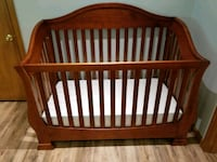 baby's brown wooden crib Westchester County
