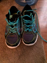 pair of blue-and-red Nike running shoes Middle Sackville, B4E 3B2