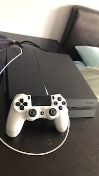 black Sony PS4 console with white controller Calgary, T2Y