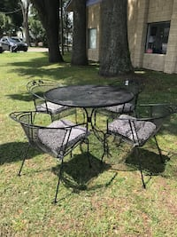 Round black metal patio table with four chairs Ocala, 34475