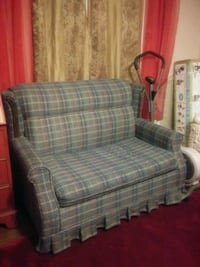 gray and black plaid sofa chair. Make an offer