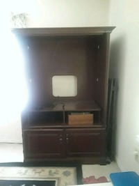 black flat screen TV with brown wooden TV hutch Macon, 31204
