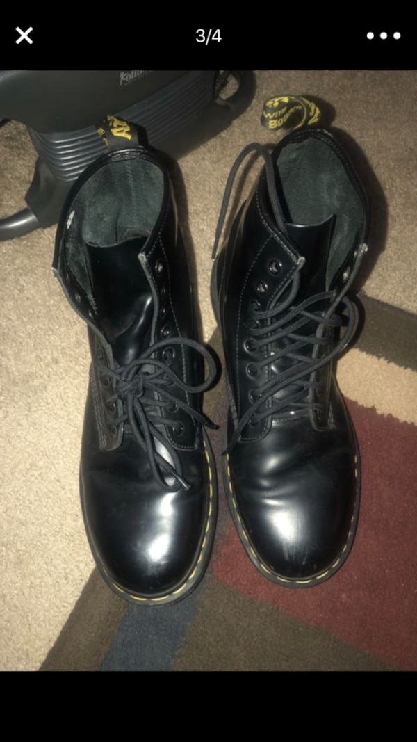 pair of black leather boots