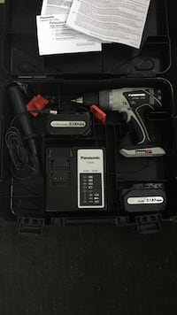 black and gray Panasonic cordless hand drill set in case 518 km