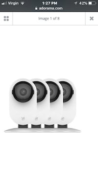 White and black security camera Raymore, 64083